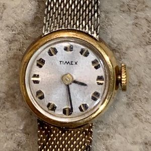 Vintage Timex Gold Color Petite Round Wind Watch.
